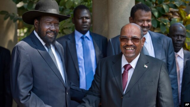 South Sudan's President Salva Kiir, left, meets with Sudan's President Omar al-Bashir, right, in the capital Juba, South Sudan, Jan. 6, 2014.
