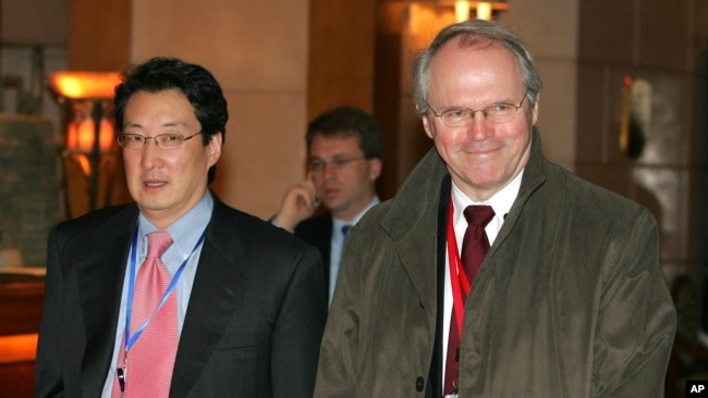 FILE - U.S. Assistant Secretary of State Christopher Hill, right, walks with Victor Cha, the U.S. National Security Council's director for Asian Affairs, before heading to six-party talks on North Korea's nuclear program in Beijing, March 22, 2007.