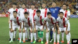 Tim nasional sepakbola China dalam Piala Asia di Brisbane, Australia tahun lalu (foto: dok).