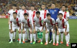 FILE - The Chinese team poses ahead of their AFC Asia Cup quarterfinal soccer match between China and Australia in Brisbane, Australia, Jan. 22, 2015.
