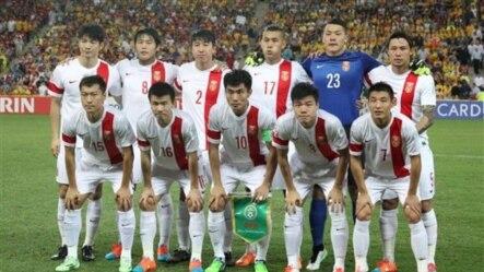 2015年1月22日,中国足球队在十六届足球亚洲杯上获得三场胜利后挺进四分之一决赛。赛前中国队员在澳大利亚布里斯班赛场合影。
