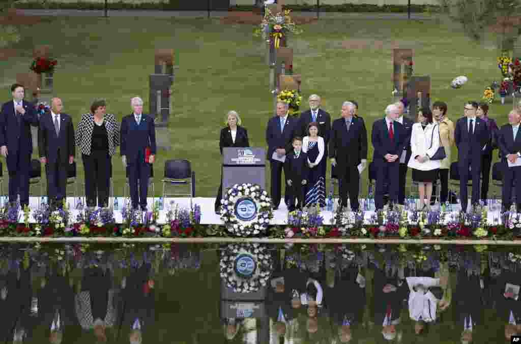Speakers, including former President Bill Clinton, fourth from left, stand at the opening of ceremonies to commemorate the 20th anniversary of the Oklahoma City bombing, at the Oklahoma City National Memorial, in Oklahoma City, Sunday, April 19, 2015.