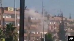 August 3 image from mobile video shows smoke rising from a building in the Al Hader area of Hama (third party image; content cannot be independently confirmed by Reuters)