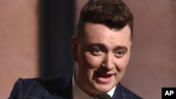 """Sam Smith accepts the award for record of the year for """"Stay With Me"""" at the 57th annual Grammy Awards, Feb 8, 2015"""