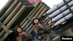 지난해 10월 평양 김일성 광장에서 열린 노동당 창건 70주년 열병식에서 군인들이 이동식 로켓 발사대에 앉아 있다. (자료사진)