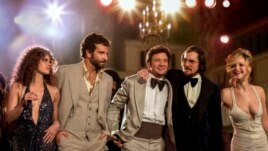 "This film image released by Sony Pictures shows, from left, Amy Adams, Bradley Cooper, Jeremy Renner, Christian Bale and Jennifer Lawrence in a scene from ""American Hustle."" The film was nominated for an Academy Award for best picture on Thursday, Jan. 1"