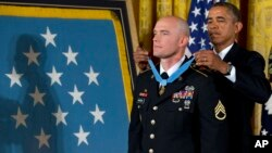 Ty Carter receives the Medal of Honor from Pres. Obama