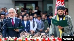 Afghanistan's former Chief Executive Officer Abdullah Abdullah and cleric Shahzada Shahid attend a swearing-in ceremony of Afghanistan's President Ashraf Ghani (not pictured), in Kabul, Afghanistan March 9, 2020.