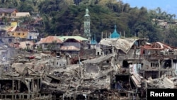 FILE - Damaged buildings are seen inside a war-torn area in Marawi City, southern Philippines, Oct. 24, 2017, after the Philippines announced on Monday the end of five months of military operations in a southern city held by pro-Islamic State rebels.