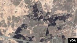 Gambar yang diambil dari udara menunjukkan sebuah desa terbakar di El Feid, negara bagian Kordofan, yang terletak antara bagian utara dan selatan Sudan.