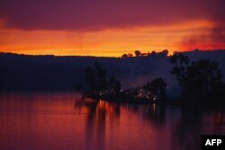 Embers glow against the smoke-filled sunset near Gumeracha in the Adelaide Hills, Jan. 3, 2015.