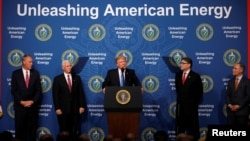 U.S. President Donald Trump participates in a discussion on energy with Energy Secretary Rick Perry (2nd-R), EPA Administrator Scott Pruitt (R), Interior Secretary Ryan Zinke (L) and Vice President Mike Pence (2nd-L), at the Department of Energy in Washin
