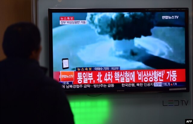 People at a railroad station in Seoul, South Korea, watch a news report on North Korea's first hydrogen bomb test, Jan. 6, 2016.