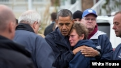 President Barack Obama hugs Donna Vanzant, the owner of North Point Marina, as he tours damage from Hurricane Sandy in Brigantine, N.J., Oct. 31, 2012. (White House/Pete Souza)
