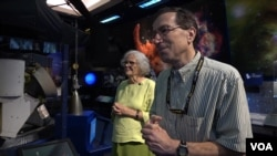 "Sue Finley and colleague Steven Lichten both work for NASA's Deep Space Network, which provides communication with space probes. Licten says colleagues regard the six-decade NASA employee as a kind of ""guru."" (M. O'Sullivan/VOA)"