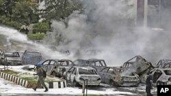 Des dizaines de voitures détruites dans l'attentat du 16 juin à Abuja