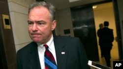"FILE - Sen. Tim Kaine, D-Va., referring to proposals to screen for those who should be prevented from owning guns, says that ""the better the background record check system, the safer people are."""