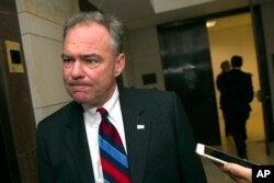 FILE - Sen. Tim Kaine, D-Va., speaks with a reporter as he arrives on Capitol Hill in Washington, July 22, 2015. Kaine is on a short list for the Hillary Clinton campaign as a vice presidential candidate.
