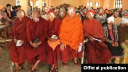 Monks sit among a group of people waiting to remove their bandages following cataract surgery. Himalayan Cataract Project