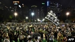 Activists hold a candlelit remembrance in Victoria Park in Hong Kong on June 4, 2020