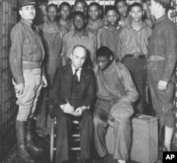 Defense attorney Samuel Leibowitz meets with his clients in Scottsboro, Alabama (1933).