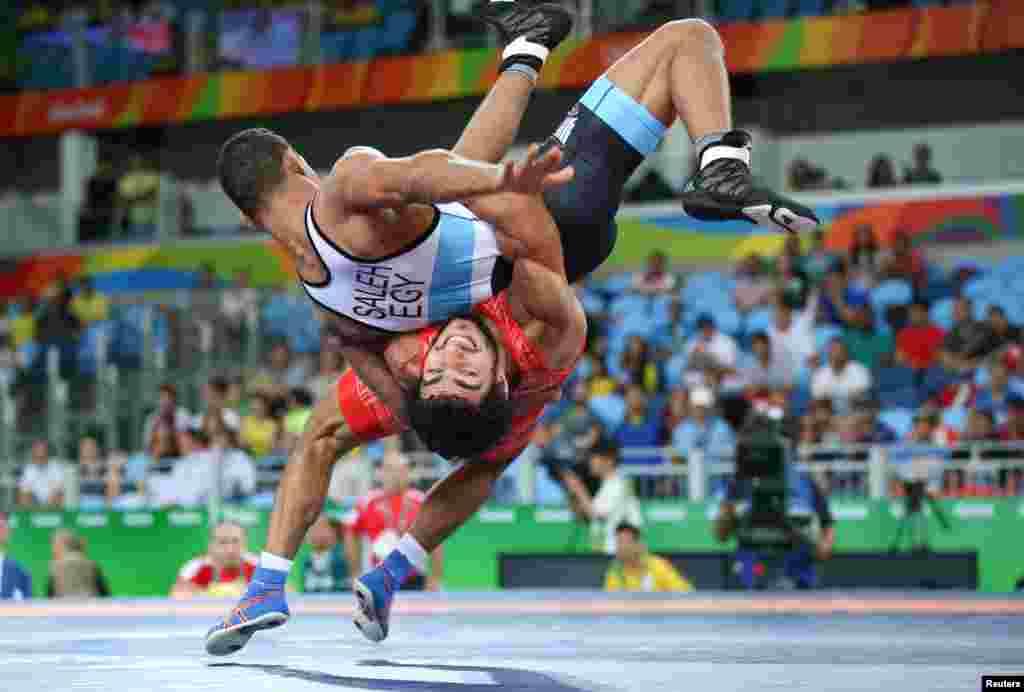 Migran Arutyunyan of Armenia and Adham Ahmed Saleh Ibrahim Kahk of Egypt compete in Greco-Roman wrestling.