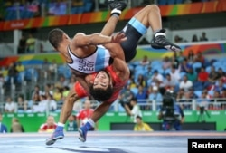 Migran Arutyunyan of Armenia and Adham Ahmed Saleh Ibrahim Kahk of Egypt compete in Greco-Roman wrestling.