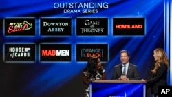 """Bruce Rosenblum, chairman and CEO, Academy of Television Arts & Sciences, center, announces """"Orange is the New Black"""" as a nominee for outstanding drama series at the 67th Primetime Emmy Nominations announcements at the Pacific Design Center in West Hollywood, California, July 16, 2015."""
