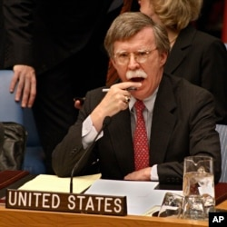 FILE - John Bolton, then the U.S. ambassador to the United Nations, listens to statements concerning the Middle East during a Security Council meeting at the U.N. headquarters in New York, Nov. 9, 2006.