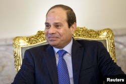 FILE - Egypt's President Abdel Fattah el-Sissi sits before a meeting at the presidential palace in Cairo, Aug. 2, 2015.