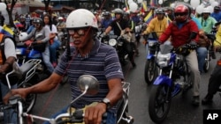 Motorcyclists attend a rally in support of Venezuela's President Nicolas Maduro in Caracas, Venezuela, Feb. 24, 2014.