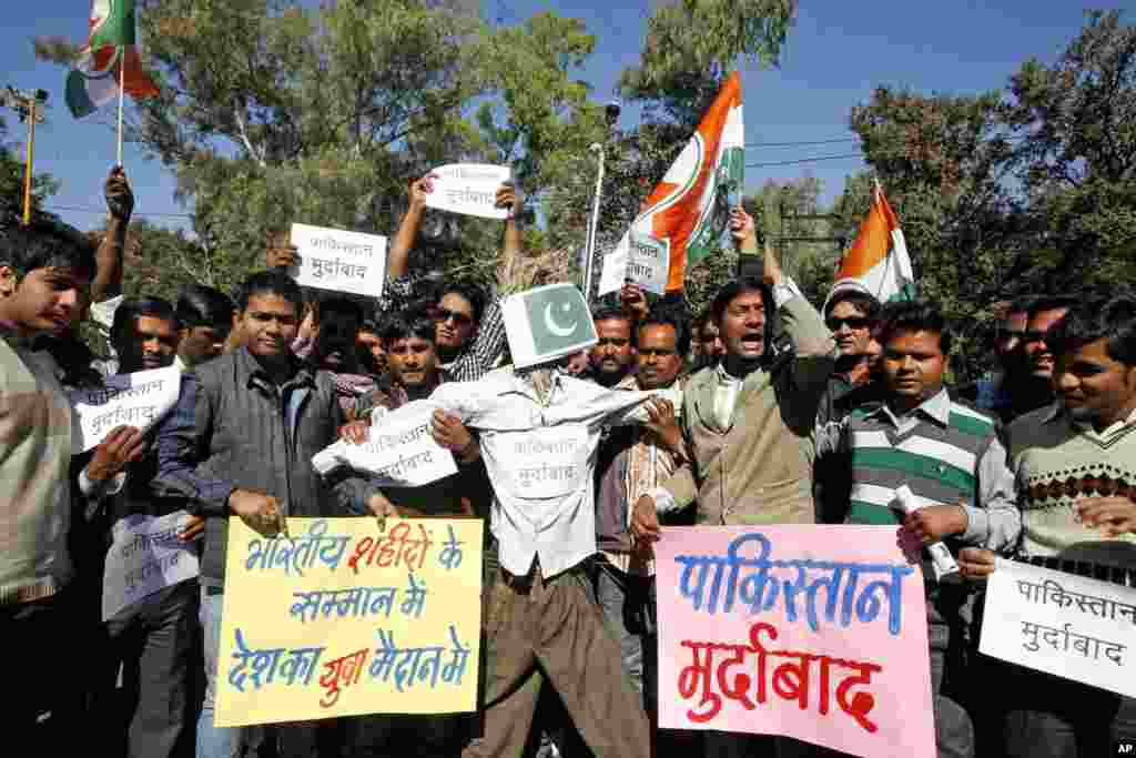 Congress party activists shout slogans before burning an effigy representing Pakistan during a protest in Bhopal, India, January 9, 2013.