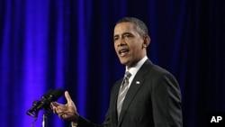 President Barack Obama speaks during a campaign event in Washington, Decemver 13, 2011.