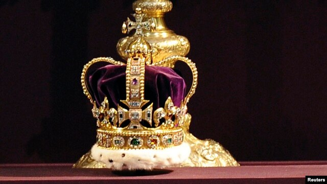 St Edward's Crown, which hasn't been outside the Tower of London for 60 years, is displayed during a service celebrating the 60th anniversary of Queen Elizabeth's coronation at Westminster Abbey in London, Britain, June 4, 2013.