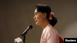 Myanmar pro-democracy leader Aung San Suu Kyi gives a speech during a World Press Freedom Day ceremony in Yangon, May 3, 2015.