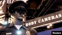 FILE _ Police body cameras are seen on a mannequin at an exhibit booth by manufacturer Wolfcom at the International Association of Chiefs of Police conference in Chicago.
