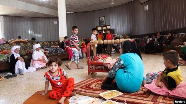 Displaced members of the Yazidi sect, fleeing Islamic State militants, take refuge in Dohuk province, Iraq, Aug. 7, 2014.