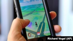 FILE - Pokemon Go is displayed on a cell phone in Los Angeles, California, July 8, 2016.