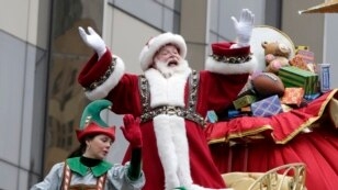Santa Claus waves at the crowd during the Macy's Thanksgiving Day Parade in New York, Nov. 27, 2014.