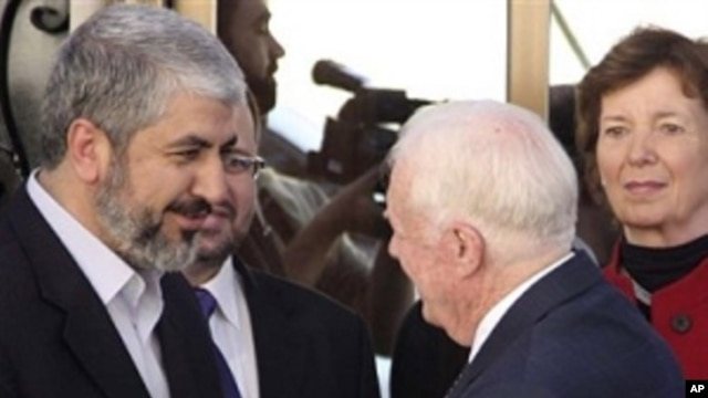 Hamas leader Khaled Mashaal, left, shakes hands with former U.S. President Jimmy Carter as former Irish President Mari Robinson, right, looks on in Damascus, Syria, Tuesday, Oct. 19, 2010