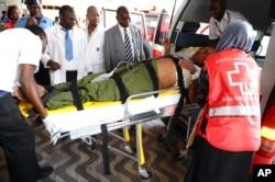 Medics help an injured person at Kenyatta National Hospital in Nairobi, Kenya, April 2, 2015, after an attack by gunmen at Garissa University College in northeastern Kenya.