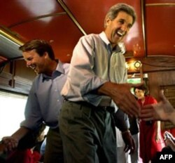 2004 Democratic Party presidential candidate John Kerry and his running mate, John Edwards, on their campaign train in Colorado