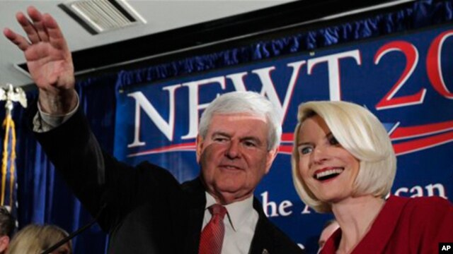 Republican presidential candidate and former House Speaker Newt Gingrich waves to the crowd with his wife Callista during a rally, Saturday, Jan. 21, 2012, in Columbia, South Carolina