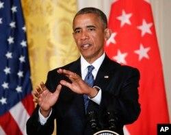 ປະທານາທິບໍດີ ສະຫະລັດ ທ່ານ Barack Obama ຕອບຄຳຖາມບັນດານັກຂ່າວ.