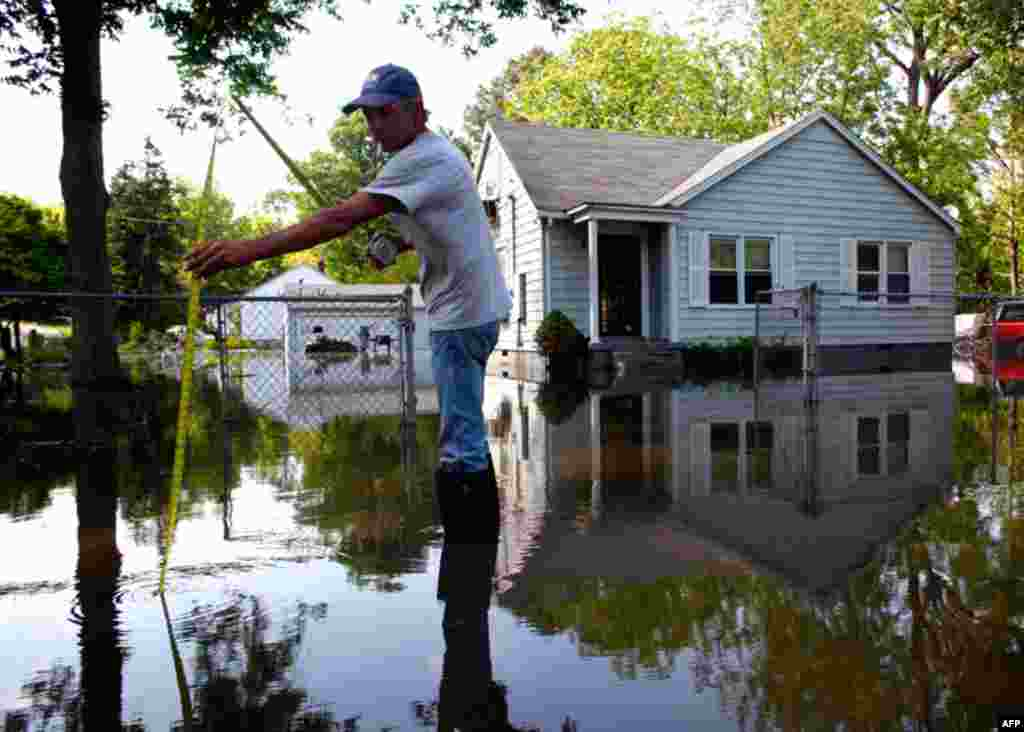 May 9: Arthur Burton measures floodwaters in Memphis, Tennessee.(REUTERS/Eric Thayer)