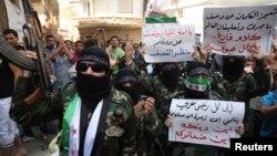 23일 시리아 알레포에서 정부군의 화학무기 공격을 규탄하는 반군들의 시위가 벌어졌다.