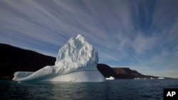 An iceberg floats in the sea near Qeqertarsuaq, Disko Island, Greenland. (AP Photo/Brennan Linsley, File)