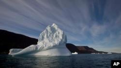 An iceberg floats in the sea near Qeqertarsuaq, Disko Island, Greenland. (AP Photo/Brennan Linsley, File)