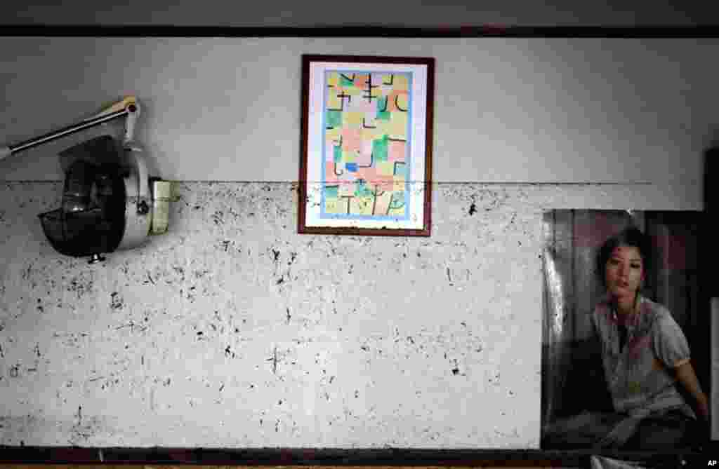 April 16: The waterline from the March 11 tsunami is left on the wall at the barber shop in Ishinomaki, Miyagi Prefecture, northeastern Japan. (AP Photo/Sergey Ponomarev)