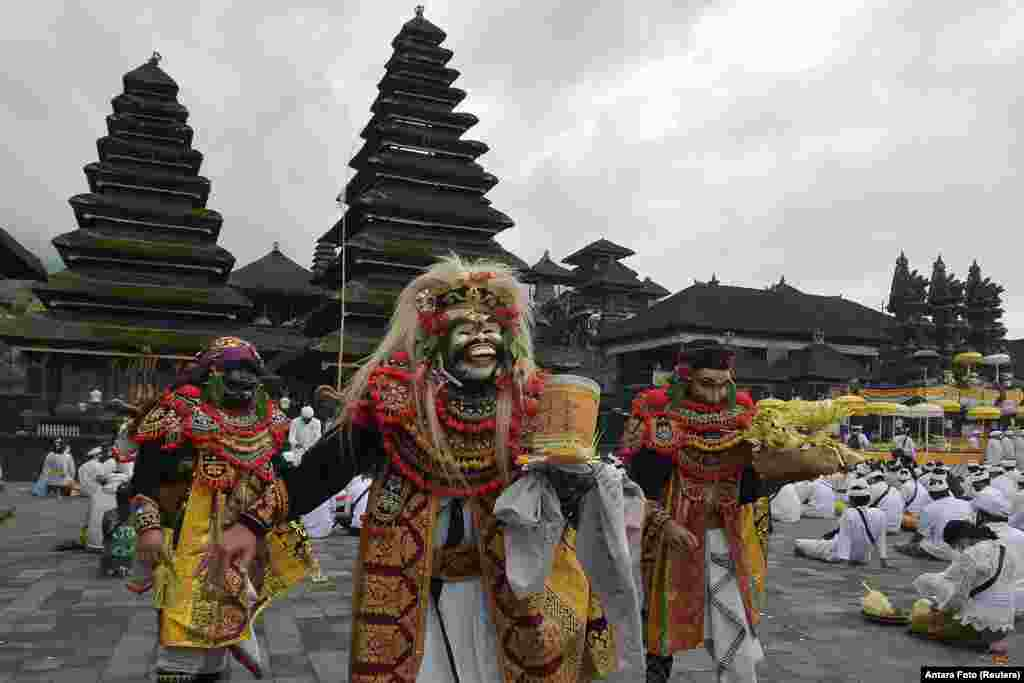 "Artists perform Sidakarya mask dancing during mass prayers, expressing gratitude for the handling of the new coronavirus and seeking blessings for the start of a ""new normal"", at Besakih temple in Karangasem, Bali, Indonesia."